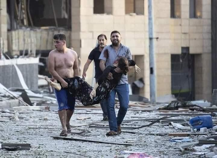 people carrying a wounded casualty